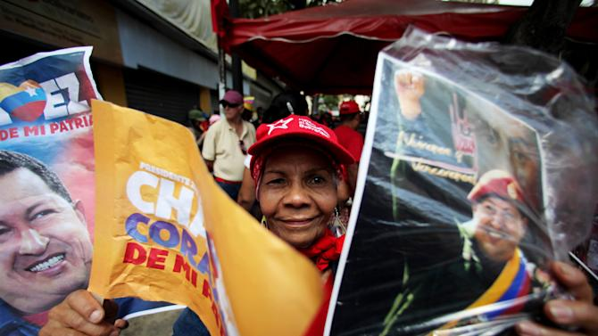A supporter of Venezuela's President Hugo Chavez celebrates his return at Bolivar Square in Caracas, Venezuela, Monday, Feb. 18, 2013. Chavez returned to Venezuela early Monday after more than two months of treatment in Cuba following cancer surgery, his government said, triggering street celebrations by supporters who welcomed him home while he remained out of sight at the Carlos Arvelo Military Hospital in Caracas, where he will continue his treatment. (AP Photo/Fernando Llano)