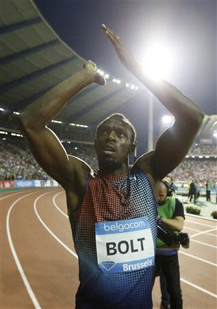 Bolt of Jamaica reacts after winning the men's 100 metres during the IAAF Diamond League athletics meeting in Brussels