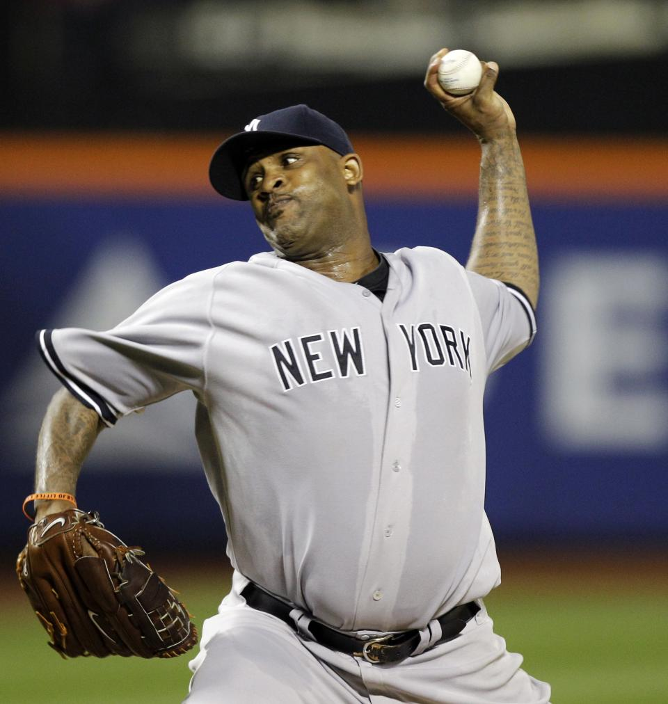 New York Yankees starting pitcher CC Sabathia delivers during the third inning of an interleague baseball game against the New York Mets at Citi Field in New York, Sunday, June 24, 2012. (AP Photo/Kathy Willens)