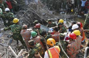 Rescuers carry a survivor pulled out from the rubble …