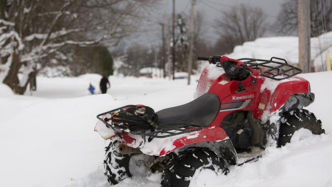 An all terrain vehicle is left in a snow bank in the town of West Seneca near Buffalo, New York