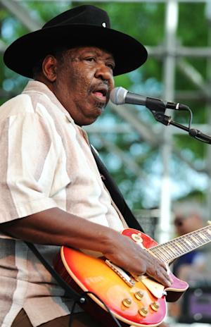 "FILE - In this July 5, 2009 file photo, Bluesman Magic Slim performs with his band ""The Teardrops"" on the final day of the Waterfront Blues Festival in Portland, Ore. Slim, a contemporary of blues greats Muddy Waters and Howlin' Wolf who helped shape the sound of the Chicago blues, has died Thursday, Feb. 21, 2013. He was 75.(AP Photo/Greg Wahl-Stephens, File)"