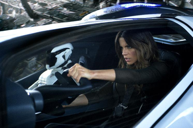 "This film image released by Columbia Pictures shows Kate Beckinsale in a scene from the action thriller ""Total Recall.""  (AP Photo/Columbia Pictures - Sony, Michael Gibson)"