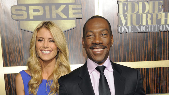 """Eddie Murphy arrives with his date Paige Butcher at """"Eddie Murphy: One Night Only,"""" a celebration of Murphy's career at the Saban Theater on Saturday, Nov. 3, 2012, in Beverly Hills, Calif. (Photo by Chris Pizzello/Invision)"""