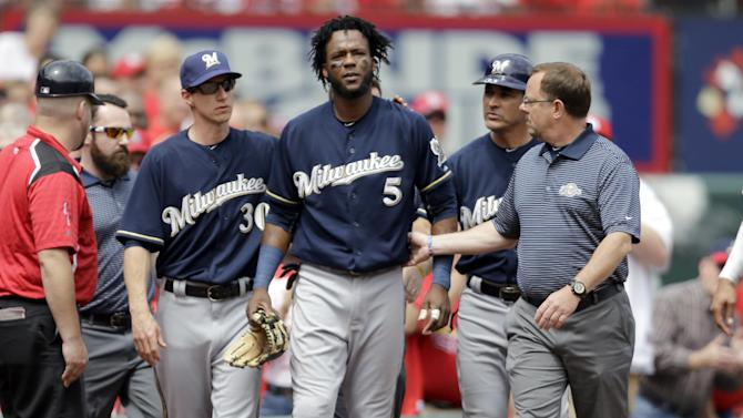 Milwaukee Brewers second baseman Hector Gomez (5) walks off the field after diving into the crowd after a foul ball by St. Louis Cardinals' Jason Heyward during the sixth inning of a baseball game Wednesday, June 3, 2015, in St. Louis. Gomez left the game. (AP Photo/Jeff Roberson)