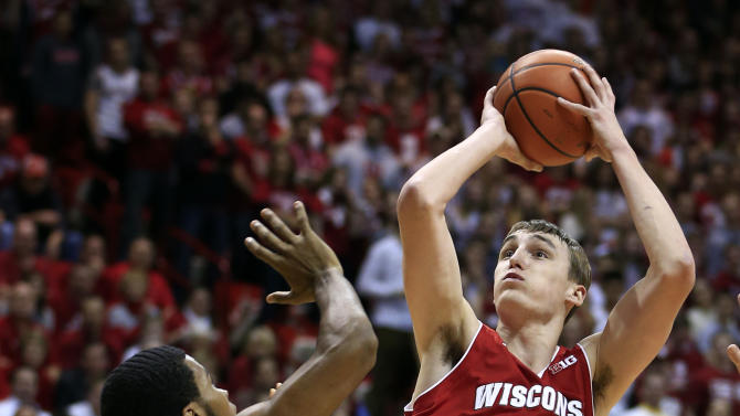 Wisconsin forward Sam Dekker (15) shoots over Indiana forward Jeremy Hollowell during the first half of an NCAA college basketball game, Tuesday, Jan. 15, 2013, in Bloomington, Ind. (AP Photo/Darron Cummings)
