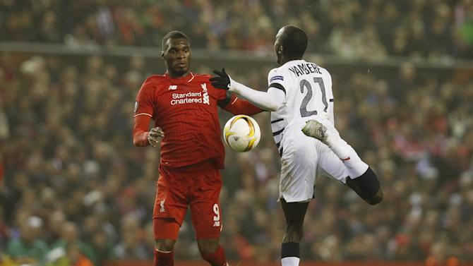 Liverpool's Christian Benteke in action with Bordeaux's Cedric Yambere