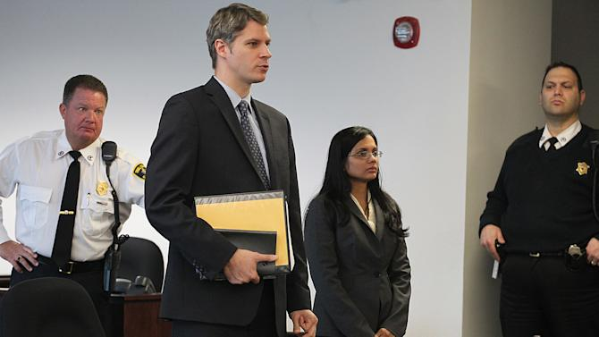 Former state lab chemist Annie Dookhan, second from right, stands in Middlesex Superior Court for arraignment on Wednesday, Jan. 9, 2013, with her attorney Nick Gordon, second left, in Woburn, Mass. Dookhan pleaded not guilty to three counts of obstruction of justice.  She is charged in connection with altering drug evidence during the testing process and obstructing justice. Prosecutors allege Dookhan fabricated test results and tampered with drug evidence while testing substances in criminal cases.  (AP Photo/The Boston Globe, Suzanne Kreiter, Pool)