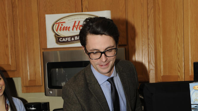 Actor Matthew Goode drinks Tim Hortons cafe & bake shop coffee at the Fender Music lodge during the Sundance Film Festival on Monday, Jan. 21, 2013, in Park City, Utah. (Photo by Jack Dempsey/Invision for Fender/AP Images)