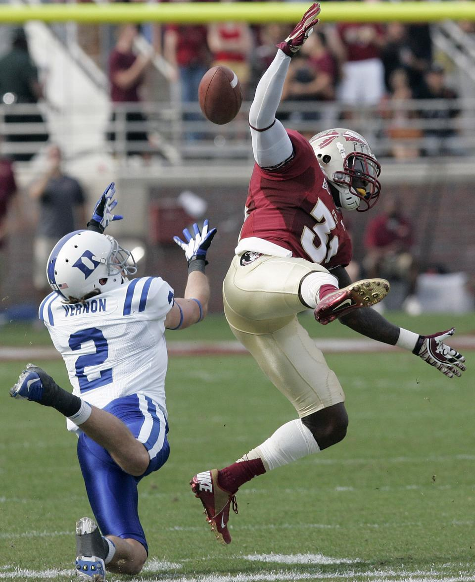 Duke's Conner Vernon can't make the reception under pressure from Florida State's Terrence Brooks in the first quarter of an NCAA college football game on Saturday, Oct. 27, 2012, in Tallahassee, Fla. Florida State won the game 48-7. (AP Photo/Steve Cannon)