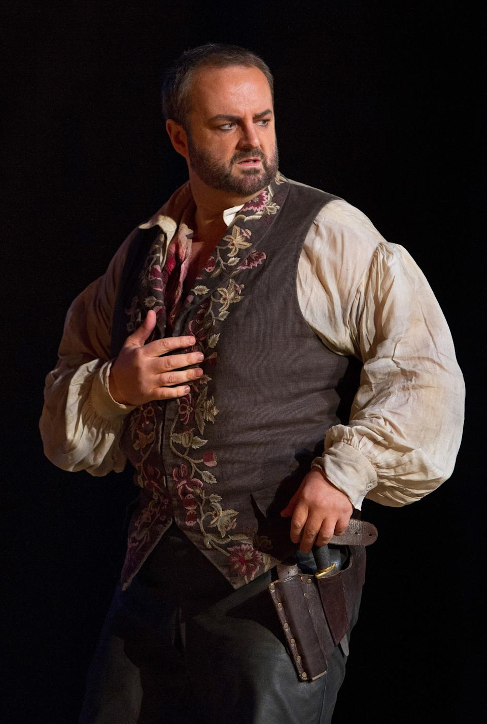 "In this Sept. 27, 2012 photo provided by the Metropolitan Opera, Gwyn Hughes-Jones plays the role of Manrico during a dress rehearsal of Verdi's ""Il Trovatore,"" at the Metropolitan Opera in New York. (AP Photo/Metropolitan Opera, Marty Sohl)"