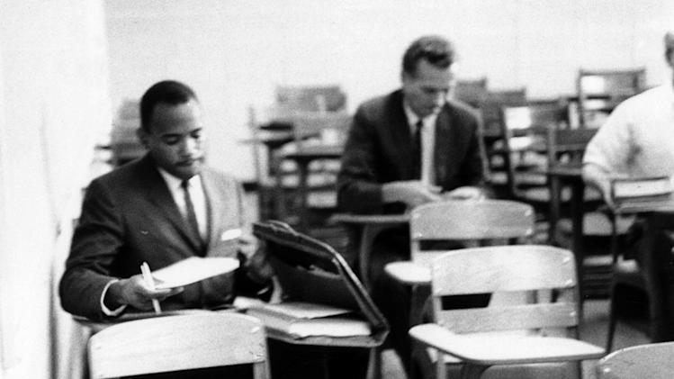 FILE - In this Oct. 2, 1962 photo provided by the University of Mississippi, James Meredith, left, attends class for the first time in Peabody Hall on The University of Mississippi campus, in Oxford, Miss.  Meredith, the first black student to attend the University of Mississippi after integration, says he doesn't plan to participate in the university's commemoration of his history-making enrollment 50 years ago, which prompted a state-federal standoff, sparked deadly mob violence and ultimately ended the university's official policy of racial segregation.  (AP Photo/University of Mississippi Public Relations, Ed Meek, File) MANDATORY CREDIT, NO SALES