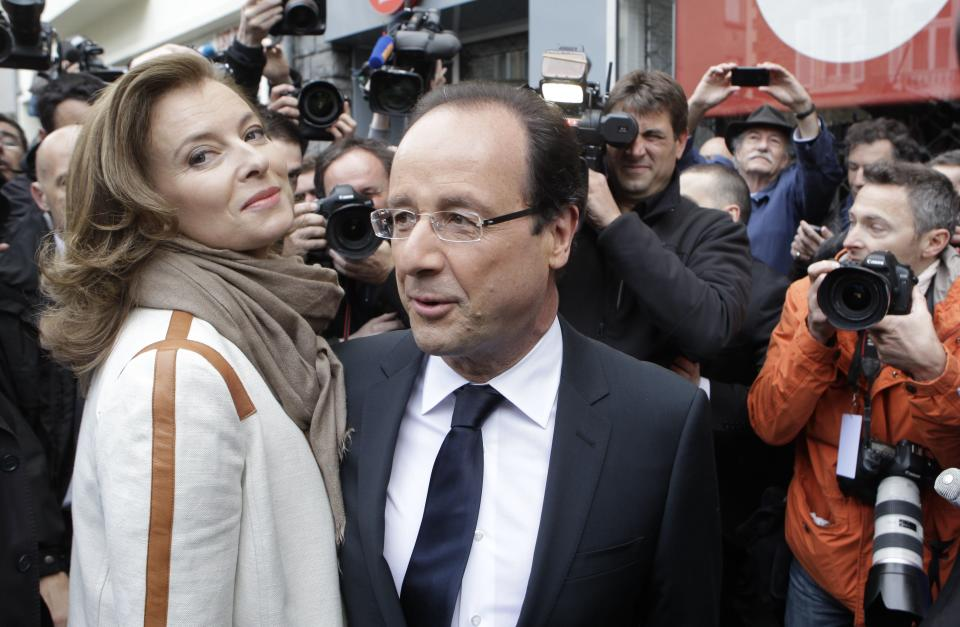 Socialist Party candidate for the presidential election Francois Hollande and his companion Valerie Trierweiler leave after voting in the second round of the presidential election in Tulle, central France, Sunday, May 6, 2012.  (AP Photo/Lionel Cironneau)