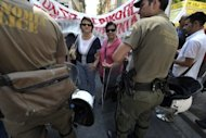 &lt;p&gt;Blind protesters face police during a demonstration of disabled people protesting against cuts in Greece. France&#39;s finance minister and the IMF both indicated that Greece could be given some breathing space implementing its austerity programme, provided it pushed through promised cuts.&lt;/p&gt;