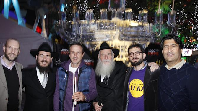 "IMAGE DISTRIBUTED FOR AEG - From left, Eric ""Ezzy"" Rappaport, Rabbi Cunin, David Arquette, Rabbi Cunin, Chaim Marcus and AEG's V.P. of Communications Michael Roth seen at AEG Season of Giving celebrates Chanukah with David Arquette and Chabad's Rabbi Cunin on Sunday, Dec. 9, 2012 in Los Angeles. (Photo by Joe Kohen/Invision for AEG/AP Images)"
