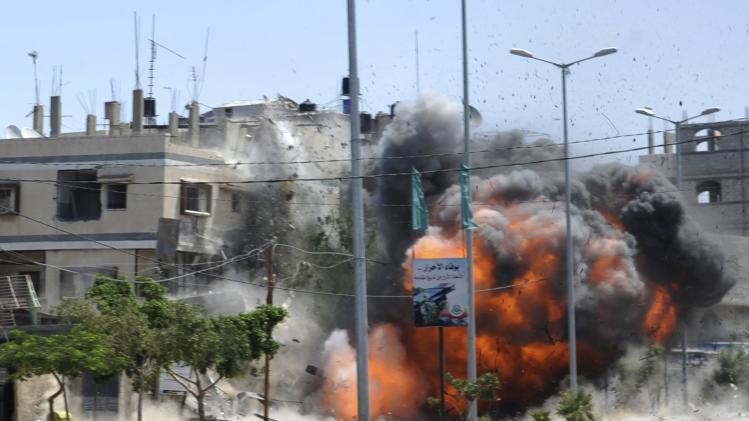 A view of what witnesses said was an explosion caused by an Israeli air strike on a house in Gaza City