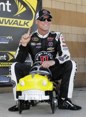 Harvick sets track record to win Kansas pole