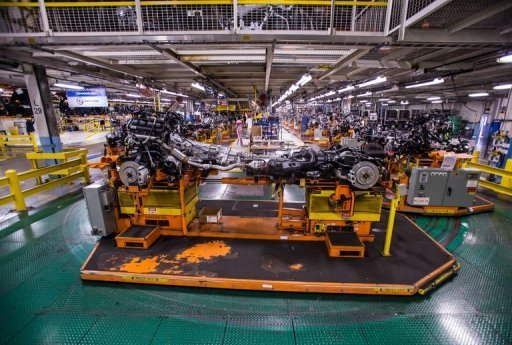 <p>The power train of a SUV moves along the assembly line in Detroit, Michigan in August 2012. US manufacturing contracted for a third straight month in August, with a key sector index hitting its lowest level since July 2009.</p>