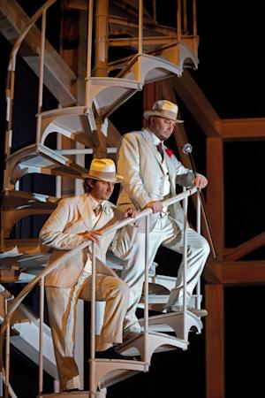 """In this November 22, 2011, photo provided by the Metropolitan Opera, Jonas Kaufmann, left, performs as the title character in Des McAnuff's new production of Gounod's opera """"Faust,"""" with and Rene Pape as Mephistopheles during a dress rehearsal at the Metropolitan Opera in New York. (AP Photo/Metropolitan Opera, Ken Howard)"""