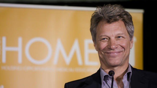 """FILE - This April 22, 2014 file photo shows musician and humanitarian Jon Bon Jovi during the grand opening of the JBJ Soul Homes in Philadelphia. Jon Bon Jovi will be honored with an award named for an opera singer. The Marian Anderson Award is given in Philadelphia to """"critically acclaimed artists who have impacted society in a positive way."""" In announcing the recipient Wednesday, July 23, organizers said Bon Jovi has used his musical success to support groups working to end homelessness and hunger. Bon Jovi will accept the $25,000 award on Nov. 18 at the city's Kimmel Center for the Performing Arts. Anderson was a celebrated contralto and Philadelphia native who in 1955 became the first black soloist at the Metropolitan Opera in New York. She died in 1993 at the age of 96. (AP Photo/Matt Rourke, File)"""