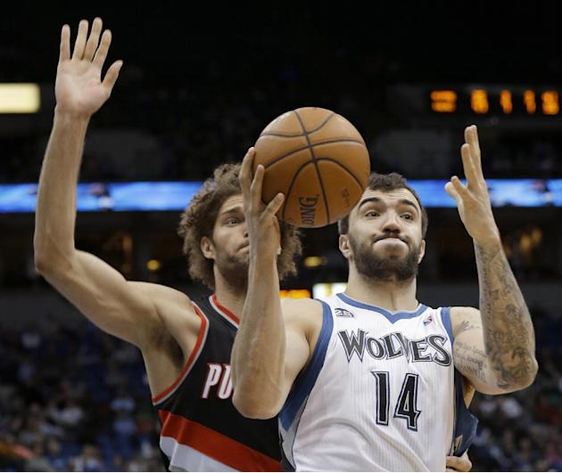 Minnesota Timberwolves center Nikola Pekovic (14), of Montenegro, pulls down a rebound in front of Portland Trail Blazers center Robin Lopez during the fourth quarter of an NBA basketball game in Minn
