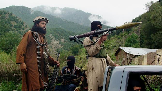 Pakistani Taliban patrol in their stronghold of Shawal in Pakistani tribal region of South Waziristan.