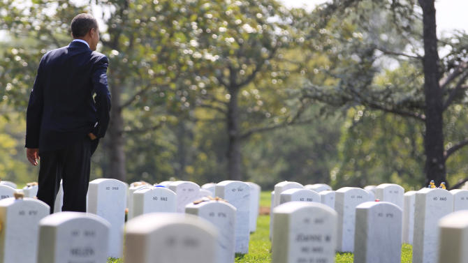President Barack Obama looks out over graves in Section 60 at Arlington National Cemetery, Saturday, Sept. 10, 2011, in Arlington, Va., where he paid his respects to those who have made the ultimate sacrifice in the past decade. Section 60, in the southeast part of the cemetery, is the burial ground for military personnel killed in the Iraq and Afghanistan wars. (AP Photo/Carolyn Kaster)