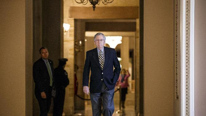 Senate Majority Leader Mitch McConnell of Ky. walks to the Senate chamber from his office on Capitol Hill in Washington, Friday, 27, 2015, as Congress closed in on approving a short-term spending bill for the Homeland Security Department that would avert a partial agency shutdown hours before it was to begin. The legislation also leaves intact Obama administration executive actions on immigration that Republicans have vowed to overturn.  (AP Photo/J. Scott Applewhite)