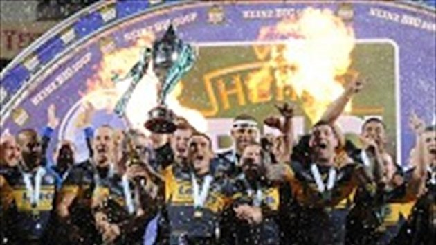 Leeds Rhino's captain Kevin Sinfield lifts the trophy after his team's victory during the World Club Challenge match at Headingley