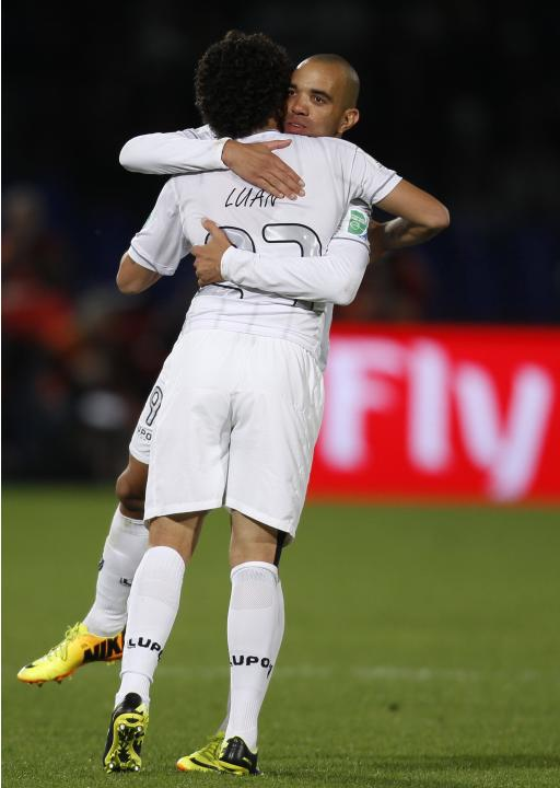 Luan of Brazil's Atletico Mineiro celebrates with Diego Tardelli after scoring his goal during their 2013 FIFA Club World Cup third place soccer match against China's Guangzhou Evergrande in M
