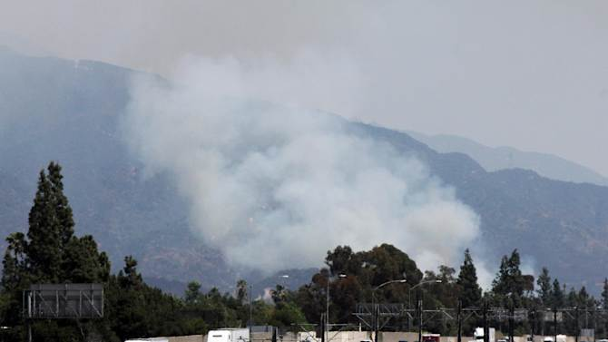 A wildfire burns on the foothills of the San Gabriel Mountains above Monrovia, Calif., on Saturday, April 20, 2013. The view of the blaze slowed traffic to a crawl on Interstate 210 northeast of  Los Angeles. (AP Photo/John Antczak)