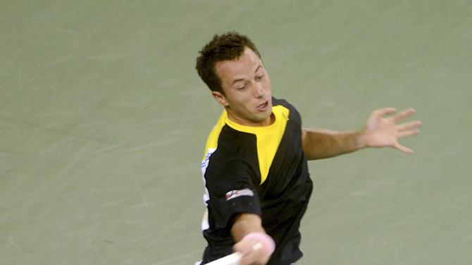 Philipp Kohlschreiber, of Germany, returns a shot to John Isner in the third round of play at the U.S. Open tennis tournament, Sunday, Sept. 2, 2012, in New York. (AP Photo/Henny Ray Abrams)