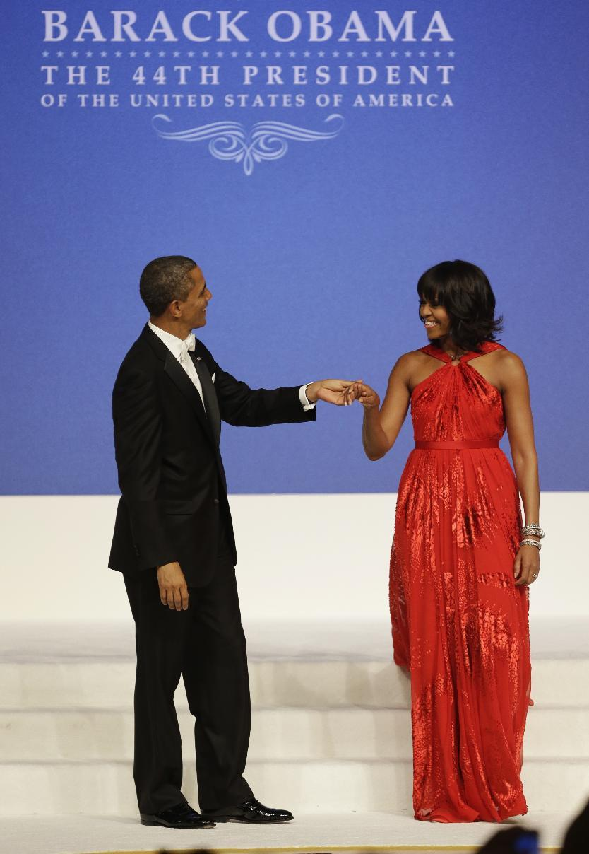 President Barack Obama and first lady Michelle Obama dance at Commander-in-Chief's Inaugural Ball at the 57th Presidential Inauguration in Washington, Monday, Jan. 21, 2013. (AP Photo/Jacquelyn Martin)