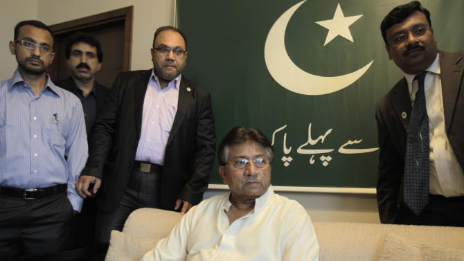 Former Pakistani President Pervez Musharraf talks to a journalist in his office before leaving to Karachi in Dubai, United Arab Emirates, Sunday, March 24, 2013. Musharraf gathered Sunday with supporters at Dubai's international airport for his planned return to his homeland after more than four years in self-exile.  (AP Photo/Kamran Jebreili)