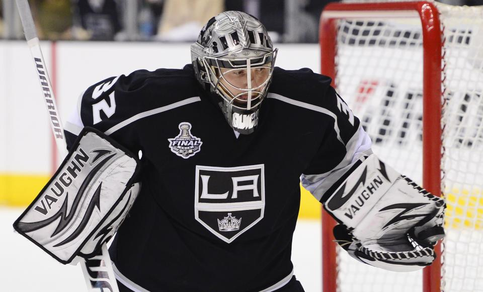 Los Angeles Kings goalie Jonathan Quick (32) makes a save against the New Jersey Devlls in the first period during Game 6 of the NHL hockey Stanley Cup finals,Monday, June 11, 2012, in Los Angeles.  (AP Photo/Mark J. Terrill)