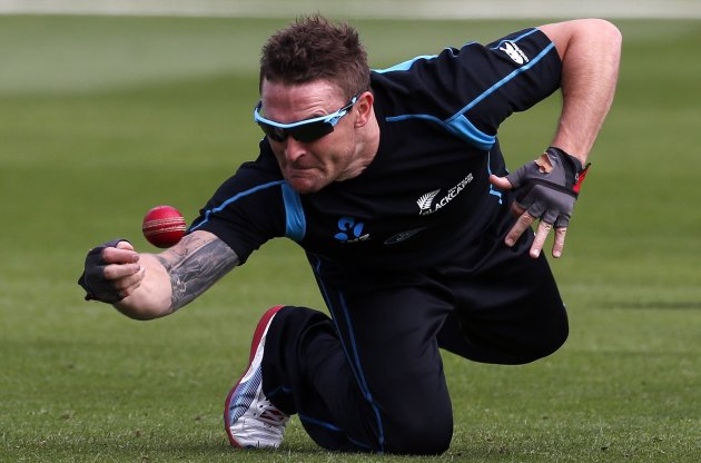 New Zealand cricket team player Brendon McCullum dives to take a catch during a training session at the University Oval in Dunedin