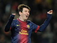 Barcelona&#39;s forward Lionel Messi celebrates after scoring during their Spanish league football match against Sevila at the Camp Nou stadium in Barcelona on February 23, 2013. Barcelona stretched their advantage at the top of La Liga to 15 points as two goals in eight minutes just before the hour mark from David Villa and Lionel Messi handed them a 2-1 win over Sevilla