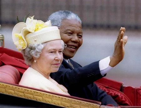 Nelson Mandela and Queen Elizabeth II ride in a carriage outside Buckingham Palace