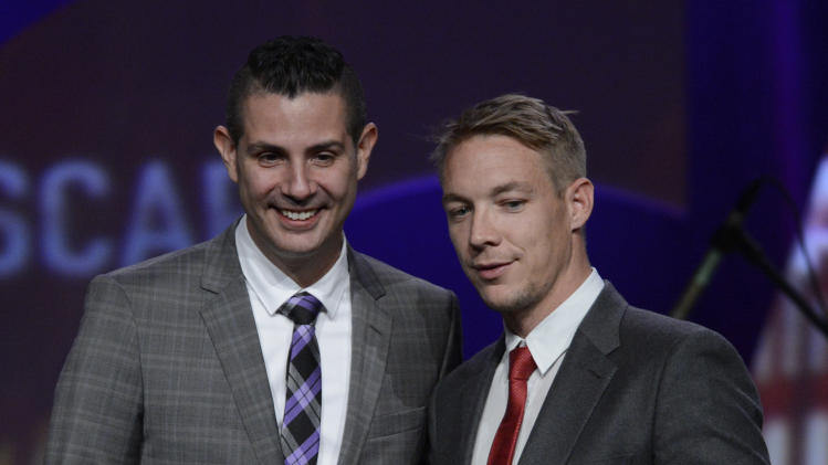 "ASCAP Senior Director, Membership - Pop/Rock Marc Emert-Hunter presents the Vanguard Award to ""Diplo""  onstage at the 30th Annual ASCAP Pop Music Awards, on Wednesday, April 16, 2013, at Loews Hollywood Hotel in Hollywood, California. (Photo by Phil McCarten/Invision for ASCAP/AP Images)"