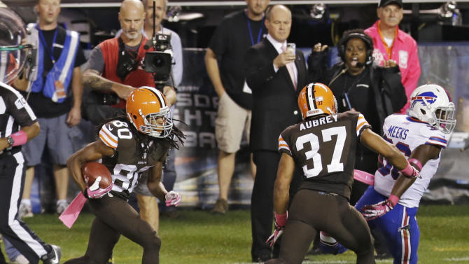 Cleveland Browns' Travis Benjamin (80) returns a punt 79 yards for a touchdown against the Buffalo Bills in the second quarter of an NFL football game Thursday, Oct. 3, 2013, in Cleveland. Browns' Josh Aubrey (37) seals off Bills' Jonathan Meeks to spring Richardson. (AP Photo/Tony Dejak)