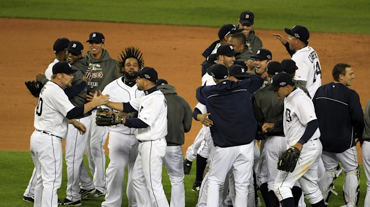 The Detroit Tigers celebrate after winning Game 4 of the American League championship series 8-1, against the New York Yankees, Thursday, Oct. 18, 2012, in Detroit. The Tigers move on to the World Series. (AP Photo/Carlos Osorio)