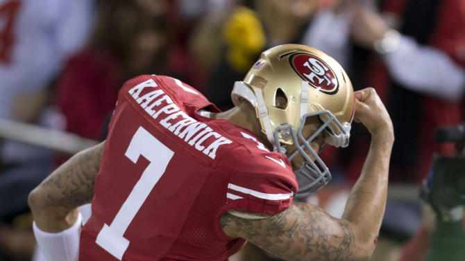 San Francisco 49ers quarterback Colin Kaepernick (7) celebrates after he ran in for a touchdown against the Green Bay Packers in the NFC Divisional Playoff on Saturday, January 12, 2013, at Candlestick Park in San Francisco, California. (Hector Amezcua/Sacramento Bee/MCT via Getty Images)