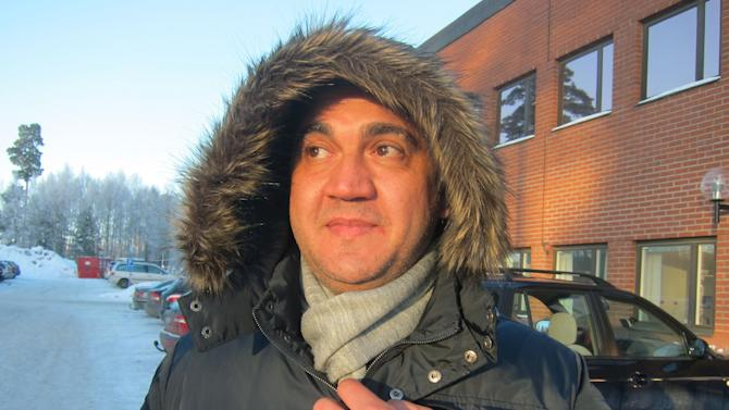 In this photo taken Jan. 23, 2013, Syrian asylum-seeker Wissam Attiki waits for a bus outside an immigration office in Marsta, Sweden. Along with Germany, which is nine times larger, Sweden stands out in Europe for its generous welcome to refugees fleeing a conflict that has killed tens of thousands and uprooted many more. European Union statistics show those two countries have received about two-thirds of the Syrians seeking shelter in the 27-nation bloc. (AP Photo/Karl Ritter)