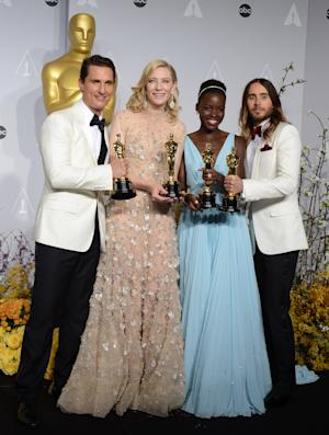 "Matthew McConaughey, from left, holds his award for best actor for his role in ""Dallas Buyers Club"", Cate Blanchett holds her award for best actress in ""Blue Jasmine"", Lupita Nyong'o holds her award for best supporting actress for ""12 Years a Slave,"" and Jared Leto holds hi award for best supporting actor in ""Dallas Buyers Club"" in the press room during the Oscars at the Dolby Theatre on Sunday, March 2, 2014, in Los Angeles. (Photo by Jordan Strauss/Invision/AP)"