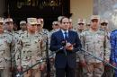 A picture released by the Middle East News Agency shows Egyptian President Abdel-Fattah el-Sisi (C) addressing journalists after an emergency meeting of the Supreme Council of the Armed Forces in Cairo on January 31, 2015