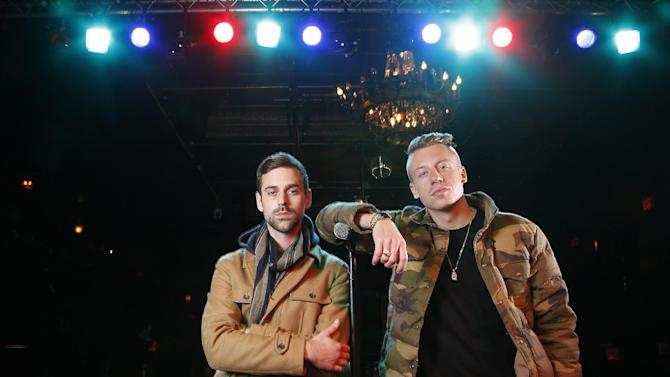 "FILE - In this Nov. 20, 2012 file photo, American musician Ben Haggerty, better known by his stage name Macklemore, right, and his producer Ryan Lewis pose for a portrait at Irving Plaza in New York.  Macklemore & Ryan Lewis feat. Wanz, ""Thrift Shop"" is the number one top streamed track for the United States on Spotify from Monday, Feb. 18, to Sunday, Feb. 24, 2013. (Photo by Carlo Allegri/Invision/AP, File)"