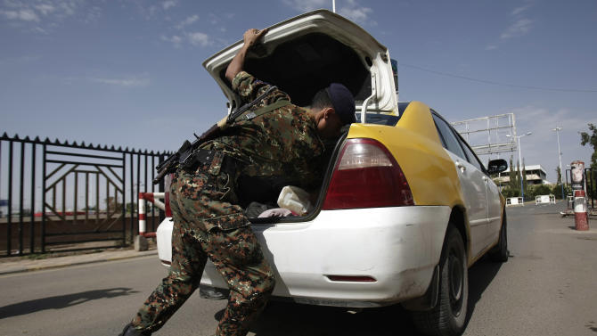 """A policeman checks a car at the entrance of Sanaa International Airport, in Yemen, Wednesday, Aug. 7, 2013. The State Department on Tuesday ordered non-essential personnel at the U.S. Embassy in Yemen to leave the country. The department said in a travel warning that it had ordered the departure of non-emergency U.S. government personnel from Yemen """"due to the continued potential for terrorist attacks"""" and said U.S. citizens in Yemen should leave immediately because of an """"extremely high"""" security threat level. (AP Photo/Hani Mohammed)"""