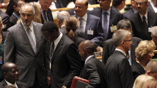 Syrian Ambassador to the United Nations Bashar Al-Jaafari, left, arrives for the 67th session of the United Nations General Assembly at U.N. headquarters Tuesday, Sept. 25, 2012.  (AP Photo/Mary Altaffer)