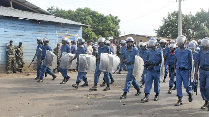 Burundian riot police patrol in the capital Bujumbura, Burundi Monday, April 27, 2015. Street protests continued Monday in Burundi as anger mounts over the ruling party's decision on Saturday to nominate President Pierre Nkurunziza for a third term. (AP Photo/Eloge Willy Kaneza)