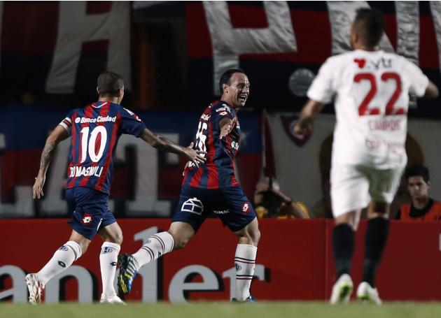 Matos and Romagnoli of Argentina's San Lorenzo celebrate after Matos scored a goal against Chile's Union Espanola during their Copa Libertadores soccer match in Buenos Aires